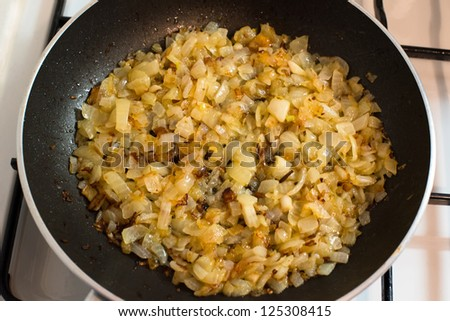 Onion frying in a pan with butter