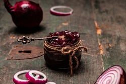onion marmalade jam confiture in bow. banner, menu, recipe, place for text.