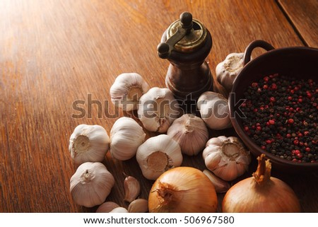 onions, cal, black pepper and red dots lie on the wooden oak table Stock fotó ©