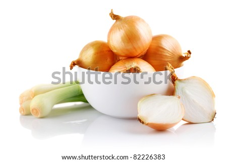 onions vegetables in white plate with cut isolated on white background - stock photo