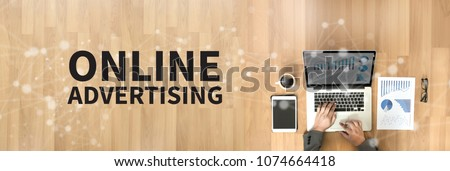 ONLINE ADVERTISING Business team work with financial reports banner with copy space #1074664418