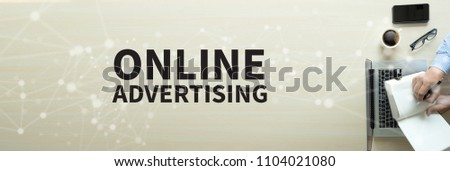 ONLINE ADVERTISING Business team work with financial reports banner with copy space #1104021080