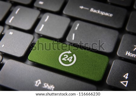 Online business always open concept: green key with 24 working hours symbol on laptop keyboard. Included clipping path, so you can easily edit it.