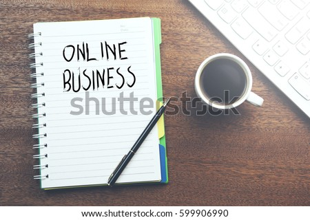 online business written on notebook with keyboard and coffee #599906990