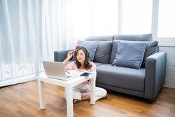 Online class learning student studying lockdown quarantine homeschooling distance learning education, Asian beautiful girl living room study at home computer laptop note book video call communication
