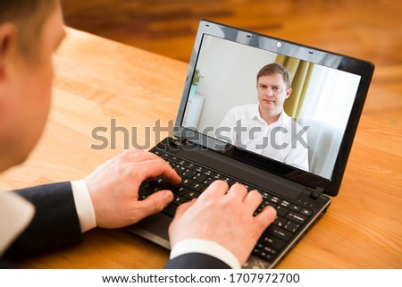 online conference.  businessman using laptop making video call to business partner. Home office. Working from home.
