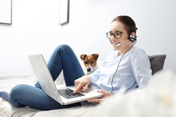 Online conversation via messenger. Young attractive woman uses the messenger and the computer.