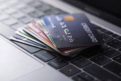 Online credit card payment for purchases from online stores and online shopping, Credit card close up shot.