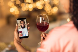 Online Date, Safe Meeting With Friends. Over The Shoulder Back View Of African American Woman Talking By Video Chat To Her Boyfriend Using Smartphone And Drinking Red Wine. Stay Home. Social Distance.