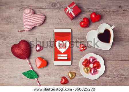 Online dating concept with smartphone mock up and heart chocolates. Valentine's day romantic celebration. View from above #360825290