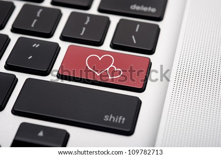 Online dating on computer keyboard