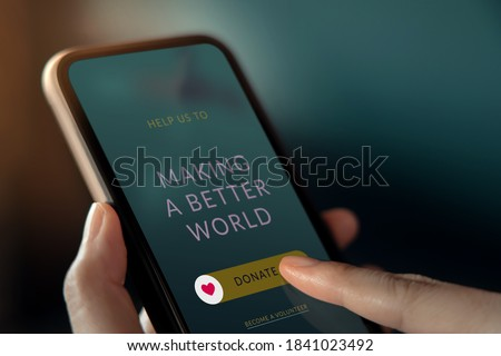 Online Donation, Volunteer and Charity Concept. Woman Making Donate via Internet on Mobile Phone. Closeup Сток-фото ©