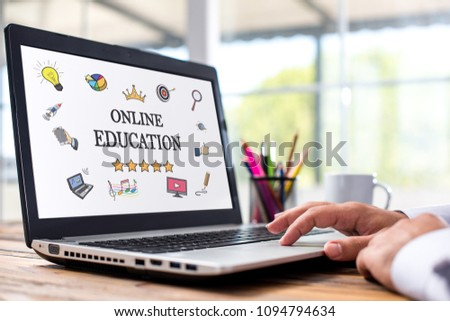 Online Education Concept With Various Hand Drawn Doodle Icons On Laptop Monitor