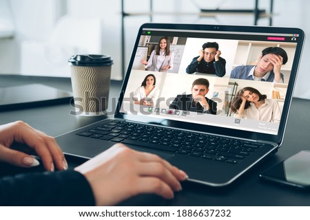 Online education. Distance learning. Video chat. Virtual class. Pandemic WFH. Bored tired diverse multiracial students group listening female teacher lesson on laptop at modern home workplace.