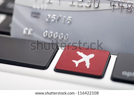 Online flight booking icon button of a computer keyboard
