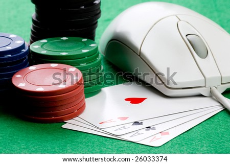 Online gaming and gambling concept, green felt, a mouse and cards
