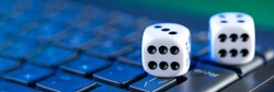 Online gaming platform, casino and gambling business. Dice on laptop keyboard on green background.