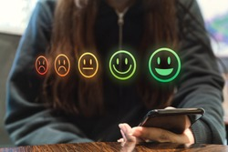 Online internet shopping customer review retail experience using feedback happy and sad icons during digital satisfaction survey - Email questionnaire sent to client for business service evaluation