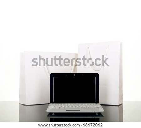 Online Internet Shopping, style laptop and white gift bag
