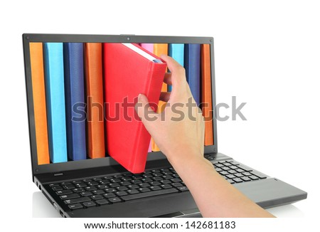 Online Learn. Laptop computer with library books