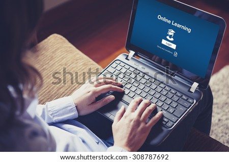 Online Learning website page in a laptop screen. Woman using a computer to learn by internet on the sofa at home