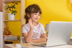 Online lessons for children. Homeschooling and distance education for kids. Girl student study online with video call teacher.
