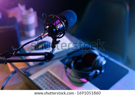 Online live radio studio desk with microphone in the foreground, entertainment and communication concept