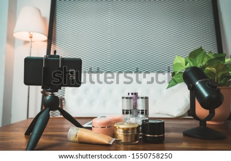 Online live streaming gadgets. Microphone, mobile phone, skin care.