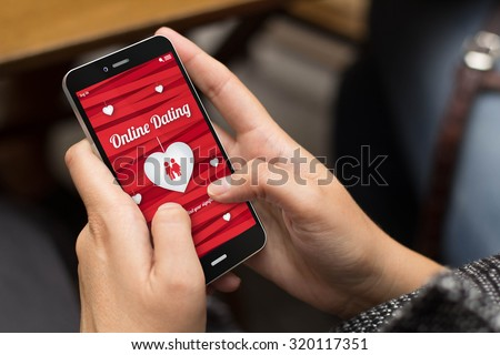 online love concept: girl using a digital generated phone with dating site on the screen. All screen graphics are made up. #320117351