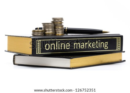 Online marketing book with coins and pen isolated on white