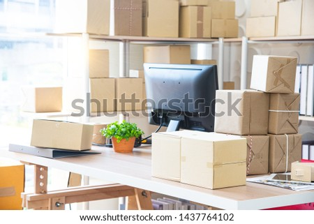 Online marketing or Shopping online business concept and box packaging,  Parcel box for delivery to customer by logistic service, The successful startup SME business