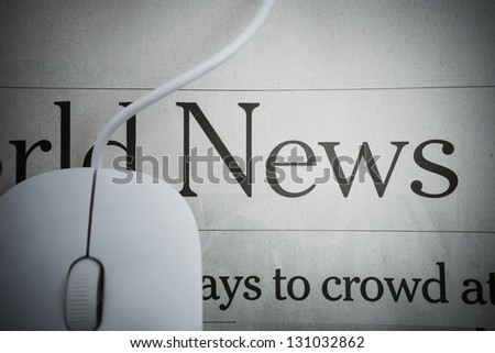 Online News -Computer mouse and Newspaper