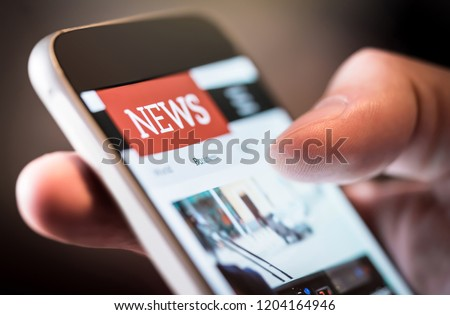 Online news in mobile phone. Close up of smartphone screen. Man reading articles in application. Hand holding smart device. Mockup website. Newspaper and portal on internet.