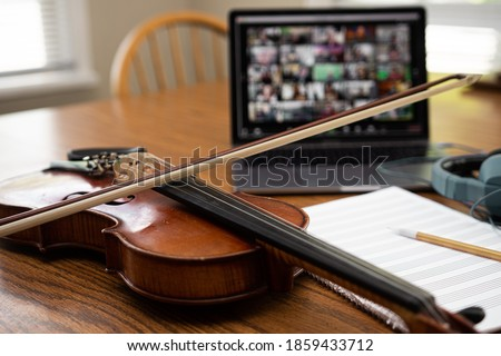 Online orchestra setup with violin, laptop computer, video conferencing Сток-фото ©