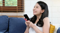 Online phone payment by credit card at home, Asian woman using mobile phone make digital money payment for shopping, Asia female girl and smartphone for E commerce, online banking concept
