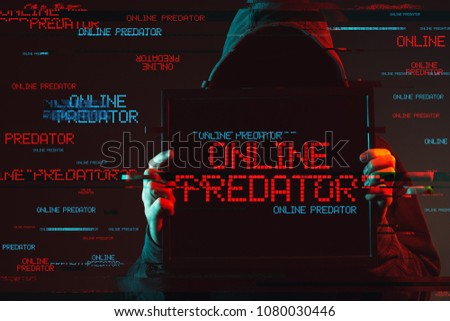 Online predator concept with faceless hooded male person, low key red and blue lit image and digital glitch effect