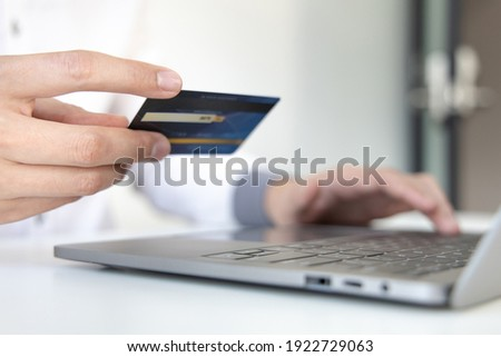 Online product purchase, Businessman use laptop register via credit cards to make online purchases, Shopping and mail, credit card online security, Online shopping concept.