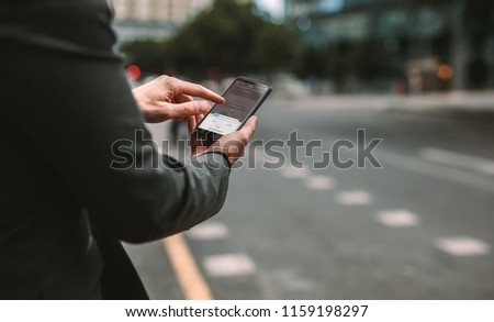 Online ride sharing and carpool mobile application. Rideshare taxi app on smartphone screen. Male commuter using online transportation service.