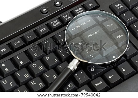 Online Search Concept. magnifying glass on keyboard
