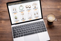Online shop website for handmade jewelry viewed on laptop computer