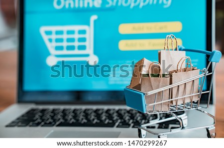 Online shopping and iot(internet of things) concept.Boxes in a trolley on a laptop. Ideas for online shopping,online shopping is consumers to directly buy goods from a seller over the internet.