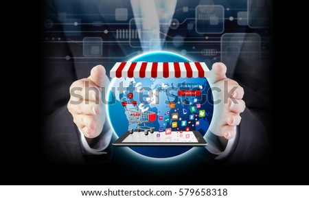 Online shopping concept of business woman hand and shopping cart on digital tablet with icon design on world background