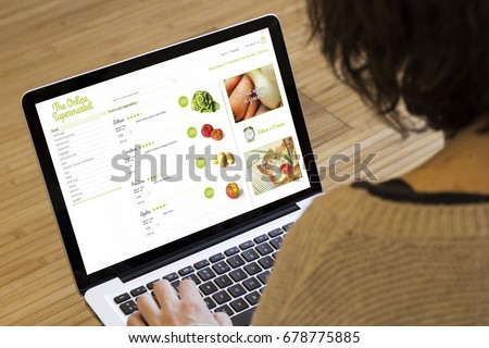 online shopping concept: online supermarket on a laptop screen. Screen graphics are made up.