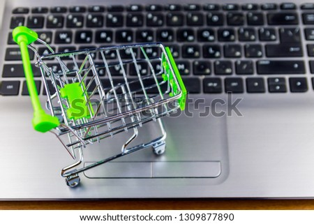 8874d55d280 Online shopping concept. Small shopping cart on laptop keyboard  1309877890