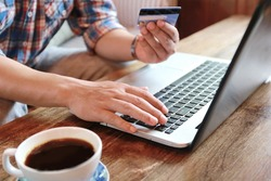Online shopping,hands holding credit card and using laptop,personal loans, working on  in coffee shop, businessman hand busy using laptop at office desk,shopping online lifestyle,