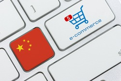 Online shopping / home shopping / product ordering, ecommerce concept : Flag of China, shopping cart with a word e-commerce on a computer keyboard, depicting buyer buys goods or things via internet