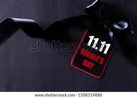 Online shopping of China, 11.11 single's day sale concept. black and red paper tag with ribbon on black background with copy space for text 11.11 single's day sale.