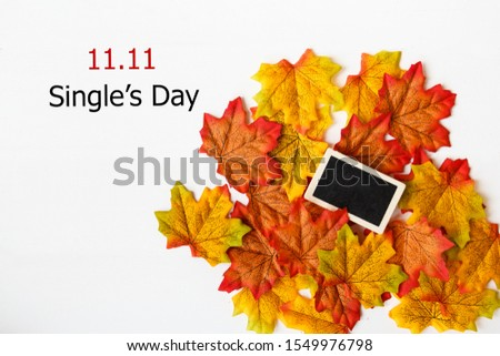 Online shopping of China, 11.11 single's day sale concept. Mini blackboard for text and maple leaf with text 11.11 single's day sale on white background.