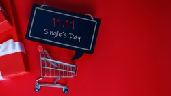 Online shopping of China, 11.11 single's day sale concept. The red gift boxes on red background with copy space for text 11.11 single's day sale.