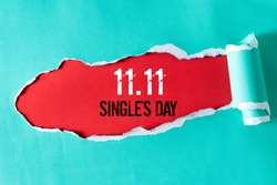 Online shopping of China, 11.11 single's day sale concept. Top view of green pastel torn paper and the text 11.11 single's day sale on a red background.